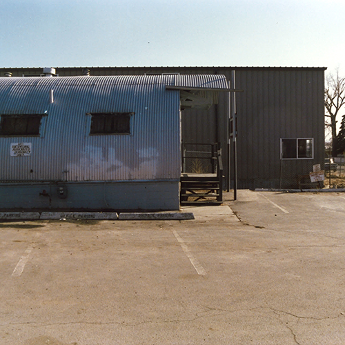 Company moves into new office, a double Quonset facility